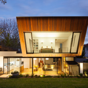 Design ideas for a contemporary two-storey exterior in Sydney with wood siding.
