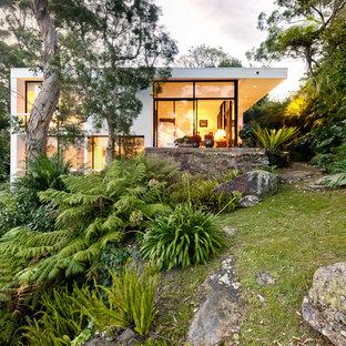 Inspiration for a modern white split-level flat roof remodel in Sydney