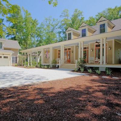 Large elegant beige two-story wood gable roof photo in Atlanta