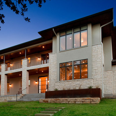 Example of a trendy stone exterior home design in Austin