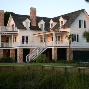 This is an example of a beach style exterior in Charleston with wood siding.