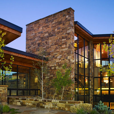 Inspiration for a contemporary mixed siding exterior home remodel in Denver