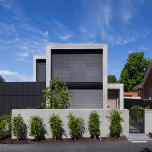 Design ideas for a contemporary two-storey grey exterior in Melbourne with a flat roof.