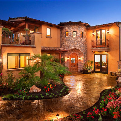Mid-sized mediterranean brown two-story stucco gable roof idea in San Luis Obispo