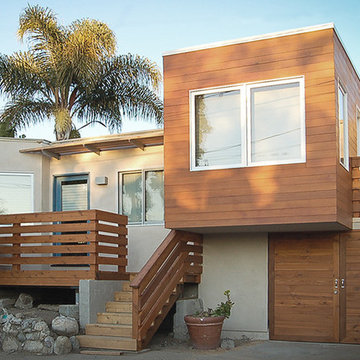 cedar-clad cantilever with flat roof