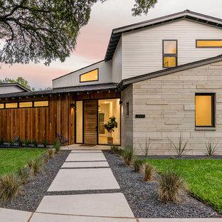 Modelo de fachada de casa multicolor, escandinava, grande, de dos plantas, con revestimientos combinados, tejado a dos aguas y tejado de metal