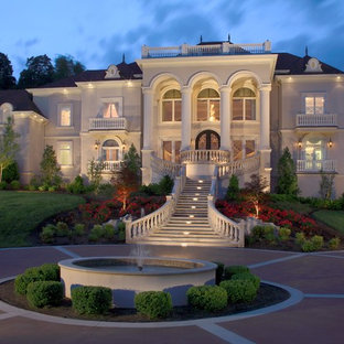 Design ideas for a traditional two-storey beige exterior in Nashville.