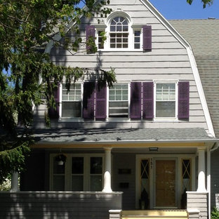 Example of a large classic gray three-story wood exterior home design in Newark