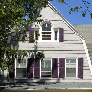 Large traditional gray three-story wood exterior home idea in Newark