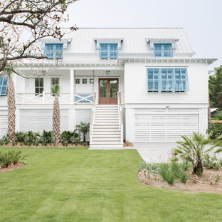 Example Of A Coastal White Exterior Home Design In Charleston With A Hip  Roof And A