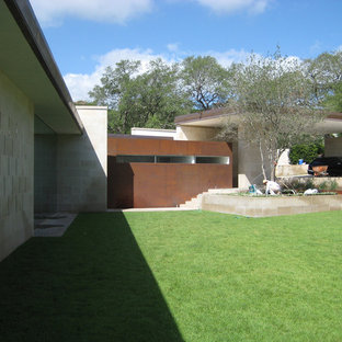 Inspiration for a large modern one-story concrete exterior home remodel in Austin