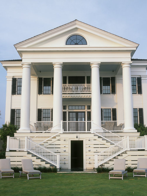 Traditional white three-story wood exterior home idea in Other