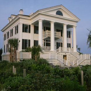 Inspiration for a large timeless white three-story wood exterior home remodel in Other