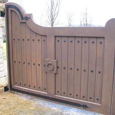Traditional Exterior by Emerald Ironworks