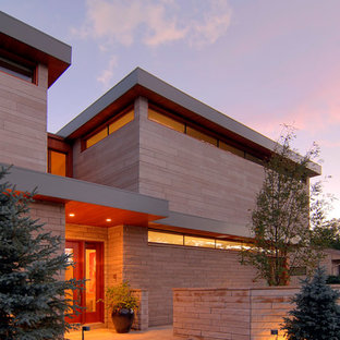 Inspiration for a large contemporary beige two-story mixed siding house exterior remodel in Denver with a shed roof