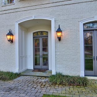 Inspiration for a large eclectic two-storey brick white exterior in Raleigh.