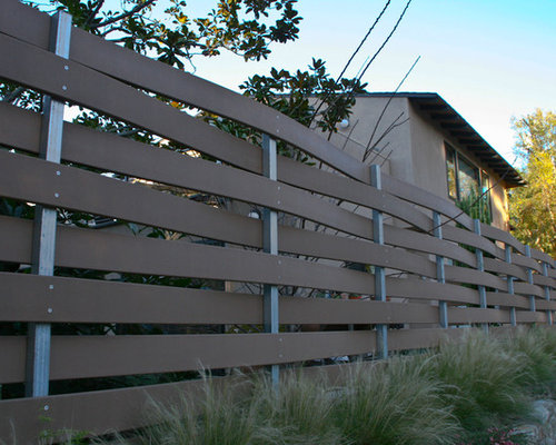 example of a minimalist exterior home design in san diego - Composite Fencing