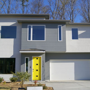 Mid-sized trendy gray two-story mixed siding house exterior photo in Charlotte with a hip roof and a shingle roof