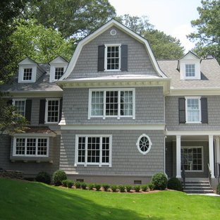 Inspiration for a large timeless gray three-story wood exterior home remodel in Atlanta with a gambrel roof