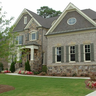 Inspiration for a timeless gray two-story brick exterior home remodel in Atlanta
