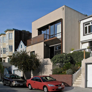 Inspiration for a mid-sized modern beige two-story stucco flat roof remodel in San Francisco