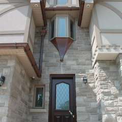 traditional exterior by Geometra Design Ltd.