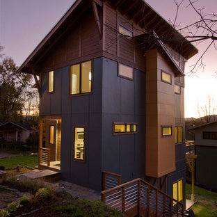 Inspiration for a contemporary wood exterior home remodel in Portland