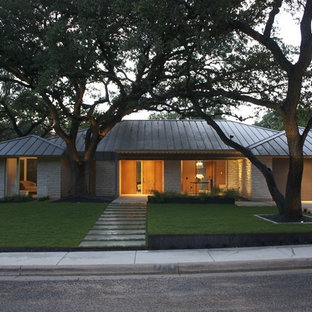 Contemporary exterior home idea in Austin with a hip roof