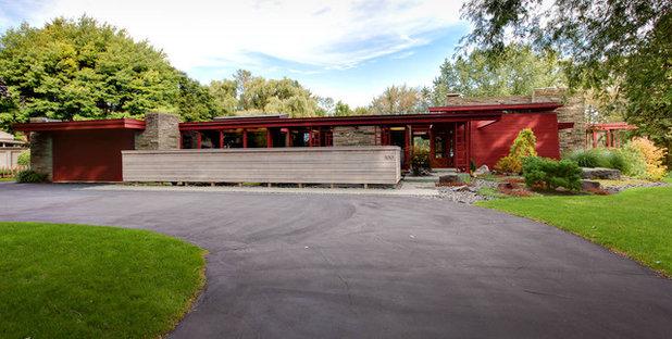 Midcentury Exterior by Genesis Architecture, LLC.