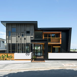 Contemporary two-storey multi-coloured house exterior in Brisbane with mixed siding and a flat roof.