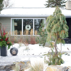 Contemporary Exterior by Marie Hebson's interiorsBYDESIGN Inc.