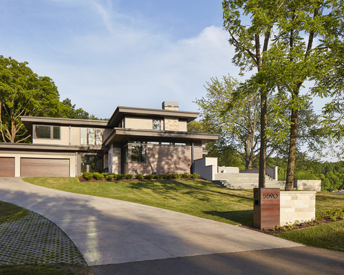 contemporary gray two story exterior home idea in minneapolis with a shed roof