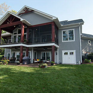 Example of a mid-sized transitional gray one-story wood exterior home design in Charlotte with a shingle roof