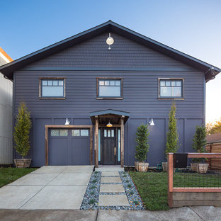 Large industrial purple two-story wood gable roof idea in San Francisco