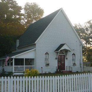 Inspiration for a huge farmhouse white two-story mixed siding exterior home remodel in Wilmington
