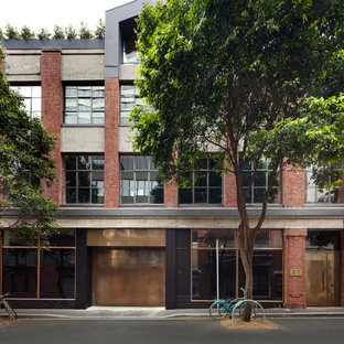 Huge industrial multicolored three-story brick townhouse exterior idea in Melbourne