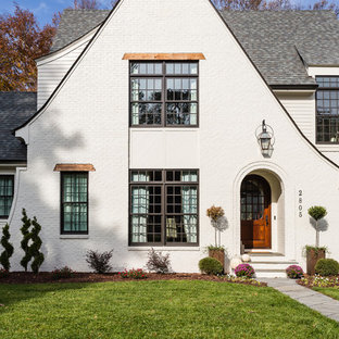 Inspiration for a mid-sized transitional white two-story exterior home remodel in Raleigh