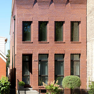 Inspiration for an industrial red two-story brick exterior home remodel in Chicago