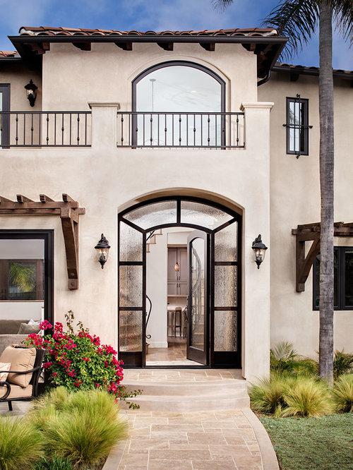 Beige split level exterior design ideas renovations photos for Split mediterranean house