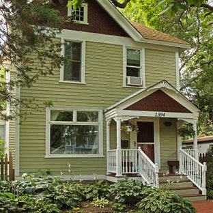 Inspiration for a victorian green two-story concrete fiberboard exterior home remodel in Minneapolis with a shingle roof