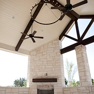 Large craftsman red one-story stone gable roof idea in Austin