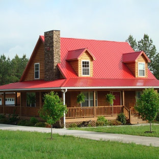 Inspiration for a mid-sized cottage brown two-story wood gable roof remodel in Jacksonville