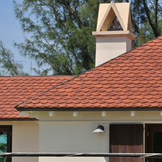 Mediterranean Exterior by Carpenter's Roofing & Sheet Metal, Inc