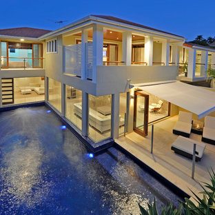 Inspiration for a mid-sized transitional beige two-story concrete exterior home remodel in Brisbane