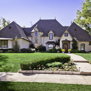 Inspiration for a timeless two-story exterior home remodel in Little Rock