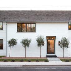 Farmhouse Exterior by Texas Construction Company