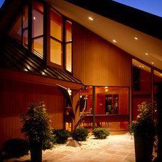 Contemporary Exterior by Erotas Building Corporation