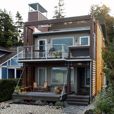Mid-sized trendy multicolored two-story mixed siding house exterior photo in Seattle with a shed roof and a metal roof