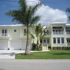 Tropical Exterior by Arieno Custom Home Design