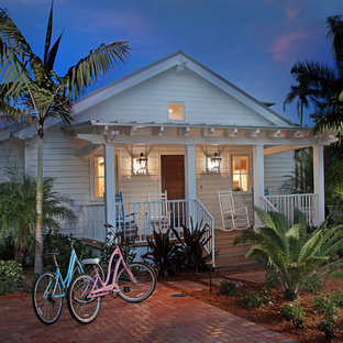 Tropical white one-story wood gable roof idea in Miami